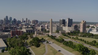 DX0001_001106 - 5.7K stock footage aerial video of the WWI memorial, the Downtown Kansas City, Missouri skyline, and Crown Center