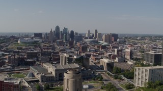 DX0001_001112 - 5.7K stock footage aerial video fly over the WWI memorial to approach the Downtown Kansas City, Missouri skyline
