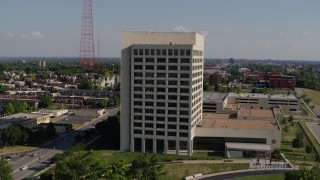 DX0001_001115 - 5.7K stock footage aerial video fly around a government office building in Kansas City, Missouri