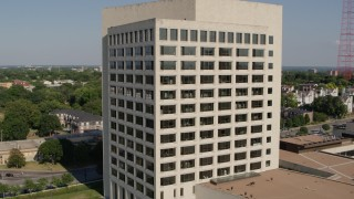 DX0001_001117 - 5.7K stock footage aerial video orbit and fly away from a government office building in Kansas City, Missouri