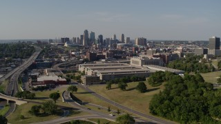 DX0001_001119 - 5.7K stock footage aerial video of a government office building and city skyline in background, Downtown Kansas City, Missouri