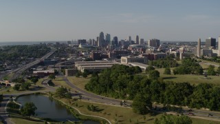 DX0001_001122 - 5.7K stock footage aerial video fly away from a government office building and city skyline, Downtown Kansas City, Missouri