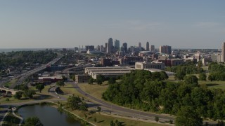 DX0001_001123 - 5.7K stock footage aerial video descend and approach government office building and city skyline, Downtown Kansas City, Missouri