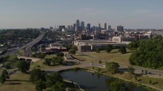 DX0001_001125 - 5.7K stock footage aerial video descend and fly away from government office building and city skyline, Downtown Kansas City, Missouri