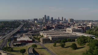 DX0001_001127 - 5.7K stock footage aerial video reverse view of a government office building and city's skyline, Downtown Kansas City, Missouri