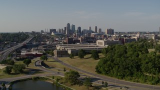 DX0001_001134 - 5.7K stock footage aerial video descend near a government building and city's skyline, Downtown Kansas City, Missouri