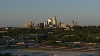 DX0001_001164 - 5.7K stock footage aerial video of the city's skyline and freeway with light traffic at sunset in Downtown Kansas City, Missouri