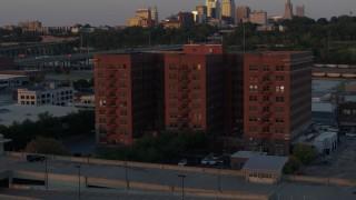 DX0001_001173 - 5.7K stock footage aerial video orbit around a brick office building at twilight in Kansas City, Missouri