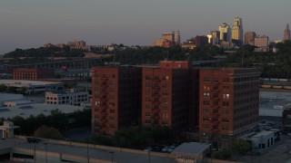 DX0001_001174 - 5.7K stock footage aerial video circle around a brick office building at twilight in Kansas City, Missouri
