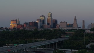 DX0001_001179 - 5.7K stock footage aerial video of city skyline reflecting the setting sun in Downtown Kansas City, Missouri, seen from I-670, twilight