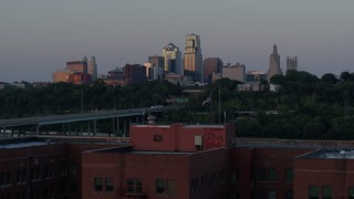 DX0001_001182 - 5.7K stock footage aerial video fly away from skyline at twilight to reveal brick building, Downtown Kansas City, Missouri