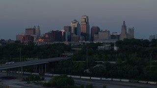 DX0001_001193 - 5.7K stock footage aerial video of the city skyline at twilight while flying near freeway in Downtown Kansas City, Missouri