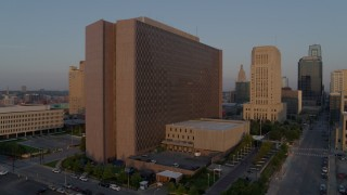 DX0001_001205 - 5.7K stock footage aerial video static and side view of a government building at sunrise, Downtown Kansas City, Missouri