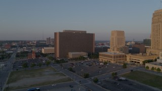 DX0001_001207 - 5.7K stock footage aerial video fly away from a government building at sunrise, Downtown Kansas City, Missouri