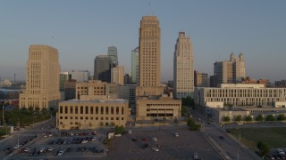 DX0001_001210 - 5.7K stock footage aerial video passing city hall and skyscraper at sunrise, Downtown Kansas City, Missouri