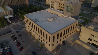 DX0001_001213 - 5.7K stock footage aerial video of approaching police station at sunrise, Downtown Kansas City, Missouri