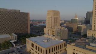 DX0001_001215 - 5.7K stock footage aerial video approach police station at sunrise, focus on courthouse, Downtown Kansas City, Missouri