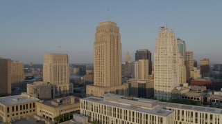 DX0001_001220 - 5.7K stock footage aerial video orbit city hall and a skyscraper at sunrise, Downtown Kansas City, Missouri