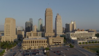 DX0001_001223 - 5.7K stock footage aerial video passing city hall and neighboring skyscraper at sunrise, Downtown Kansas City, Missouri