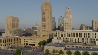 DX0001_001224 - 5.7K stock footage aerial video ascend and orbit city hall and neighboring skyscraper at sunrise, Downtown Kansas City, Missouri