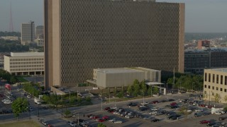 DX0001_001228 - 5.7K stock footage aerial video of a stationary view of a government office building at sunrise, Downtown Kansas City, Missouri