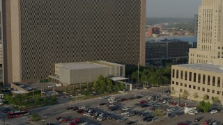 DX0001_001231 - 5.7K stock footage aerial video reverse view of lower levels of a government office building at sunrise, Downtown Kansas City, Missouri