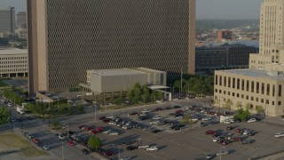 DX0001_001235 - 5.7K stock footage aerial video fly away from a government office building at sunrise, Downtown Kansas City, Missouri
