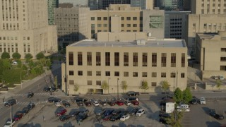 DX0001_001238 - 5.7K stock footage aerial video of a view of the downtown police station at sunrise, Downtown Kansas City, Missouri