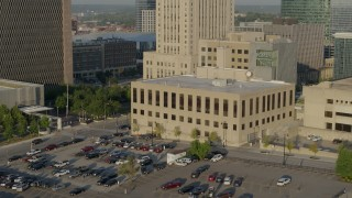 DX0001_001240 - 5.7K stock footage aerial video fly away from the downtown police station at sunrise, Downtown Kansas City, Missouri