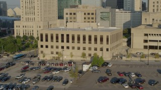 DX0001_001242 - 5.7K stock footage aerial video a static and reverse view of the downtown police station at sunrise, Downtown Kansas City, Missouri