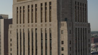 DX0001_001251 - 5.7K stock footage aerial video of a reverse view of a tall courthouse building at sunrise, Downtown Kansas City, Missouri
