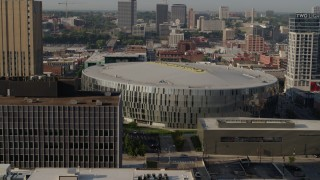 DX0001_001254 - 5.7K stock footage aerial video of orbiting a downtown arena at sunrise, Downtown Kansas City, Missouri