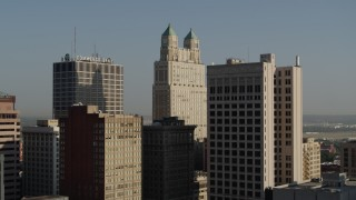 DX0001_001255 - 5.7K stock footage aerial video of a slow approach to a tall skyscraper at sunrise, Downtown Kansas City, Missouri