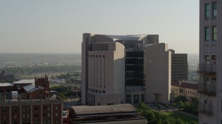 DX0001_001257 - 5.7K stock footage aerial video flyby a tall skyscraper to reveal the federal courthouse at sunrise, Downtown Kansas City, Missouri
