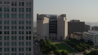 DX0001_001258 - 5.7K stock footage aerial video flyby the federal courthouse for closer view of skyscraper at sunrise, Downtown Kansas City, Missouri