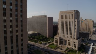 DX0001_001261 - 5.7K stock footage aerial video of government office building beside a courthouse at sunrise, Downtown Kansas City, Missouri