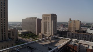 DX0001_001265 - 5.7K stock footage aerial video of flying toward the downtown courthouse at sunrise, Downtown Kansas City, Missouri