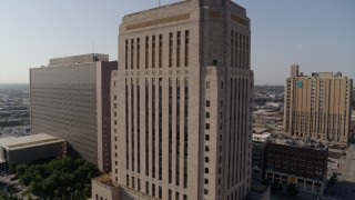 DX0001_001266 - 5.7K stock footage aerial video of flying away from the downtown courthouse at sunrise, Downtown Kansas City, Missouri