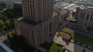 DX0001_001270 - 5.7K stock footage aerial video stationary view of city hall's front steps at sunrise, Downtown Kansas City, Missouri