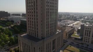 DX0001_001271 - 5.7K stock footage aerial video of orbiting city hall at sunrise, Downtown Kansas City, Missouri