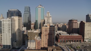 DX0001_001277 - 5.7K stock footage aerial video of a stationary view of downtown's tall skyscrapers at sunrise, Downtown Kansas City, Missouri