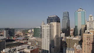 DX0001_001280 - 5.7K stock footage aerial video of approaching a downtown office building at sunrise, Downtown Kansas City, Missouri