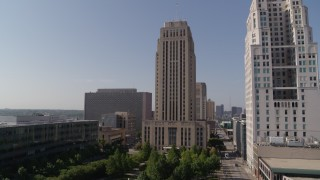 DX0001_001287 - 5.7K stock footage aerial video stationary view, flyby city hall near a tall skyscraper in Downtown Kansas City, Missouri