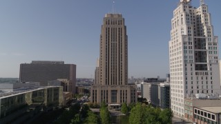 DX0001_001288 - 5.7K stock footage aerial video stationary view of city hall near a tall skyscraper in Downtown Kansas City, Missouri