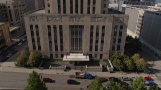 DX0001_001291 - 5.7K stock footage aerial video flying away from entrance of city hall in Downtown Kansas City, Missouri