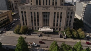 DX0001_001296 - 5.7K stock footage aerial video of flying away from the city hall entrance in Downtown Kansas City, Missouri