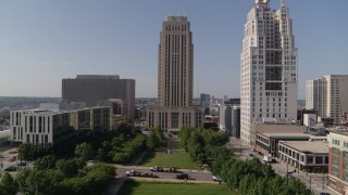 DX0001_001297 - 5.7K stock footage aerial video of flying over park to approach city hall in Downtown Kansas City, Missouri