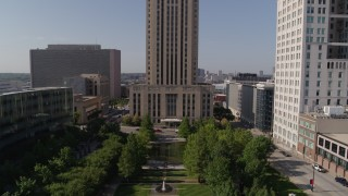 DX0001_001301 - 5.7K stock footage aerial video fly over park to approach city hall in Downtown Kansas City, Missouri
