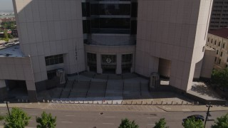 DX0001_001303 - 5.7K stock footage aerial video stationary view of federal courthouse entrance in Downtown Kansas City, Missouri