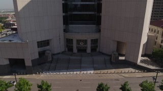 DX0001_001304 - 5.7K stock footage aerial video of a reverse view of federal courthouse entrance in Downtown Kansas City, Missouri